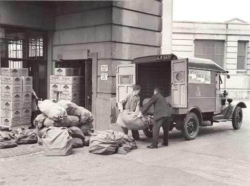 Postmen load sacks of mail from the Ovaltine factory on to a mail van.