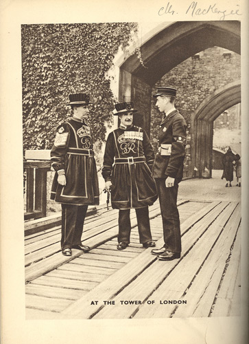 Photograph of a postman and two beefeaters at The Tower of London, as published in the Post Office Magazine, February 1939.