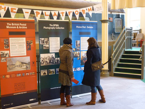 Two visitors find out more about Picture Post at The Platform, Swindon.