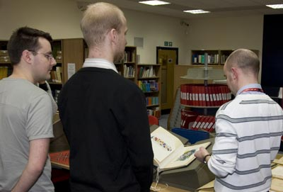 A tour is conducted around the Royal Mail Archive.