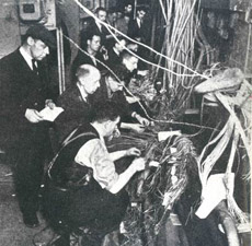 Post Office engineers re-wire a telephone exchange after an air raid. Post Office telephone engineers developed the first programmable electronic computer during the 2nd World War.