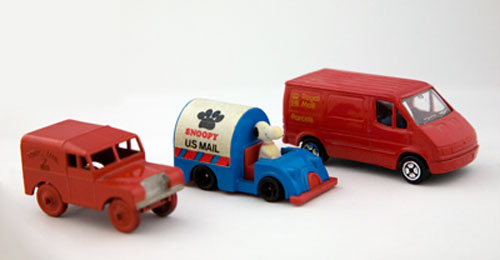 A group of vehicles from the Wilkinson Collection, including a US mail car with Snoopy