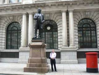 Curator Chris Taft, takes a break beside the statue of Rowland Hill, outside King Edward Building