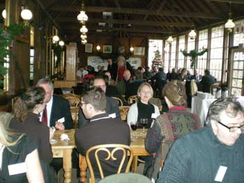 Guests enjoy festive food and mulled wine before the speeches