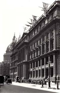 Central Telegraph Office (GPO West) decorated with flags for the Jubilee of George V.