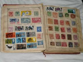 Two pages of the Lincoln Stamp Album, showing stamps from Gibraltar and Great Britain