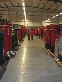 Visitors looking at pillar boxes at Britain Loves Wikipedia