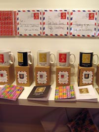A closer view of the some of the Machin-inspired cards, mugs and notebooks.