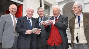 Tony Benn holding the pigeon that carried the message from Lord Bath. Watching from left to right, Brian Trotter & Alan Huggins (London 2010), Colin Baker (Bath Postal Museum) and Teddy Hendrie the pigeon's owner.