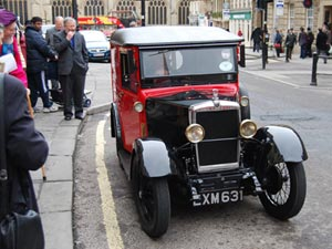 The 1935 Morris Minor postal van sets off from the Guildhall in Bath with its cargo of special event covers.
