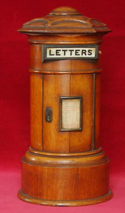 A wooden post box which is part of the Bruce Castle postal history collection