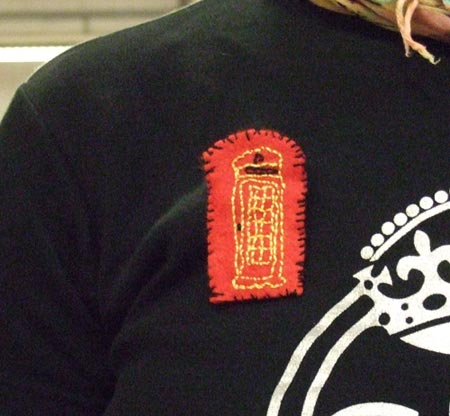 Embroidered badge stitched by a member of staff