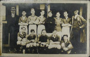 Postcard showing Manchester Messengers football team. The team played against Sheffield Messengers in an annual inter-office match on 19th October 1913, winning 2-1.