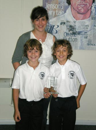 Alison Norris with Stamp It winners Joseph Brownlow and Harry Chinnock from Cawthorne Primary