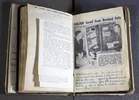 A newspaper article in the scrapbook showing how Gurr's team rescued £40,000 from a safe
