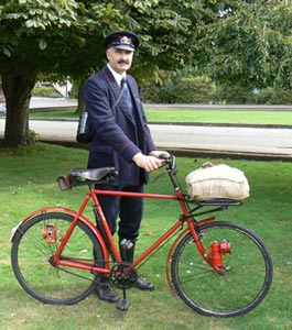 1940s postman, complete with authentic bicycle