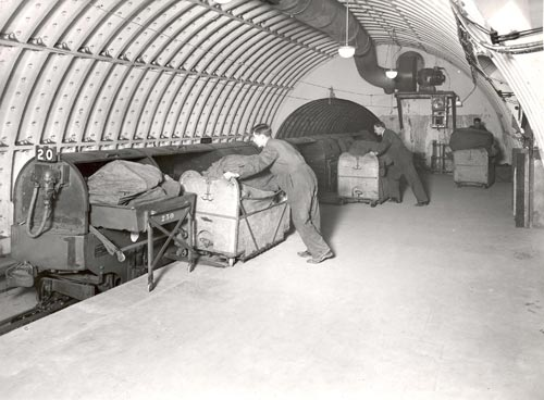 Loading carriages on the Post Office Underground Railway with mail bags