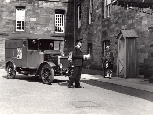 A postman delivers mail at Holyrood House, Edinburgh, 1934.