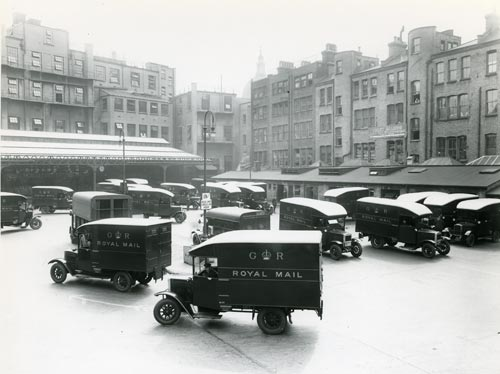 A fleet of commercial vans in the yard at King Edward Building, 1931