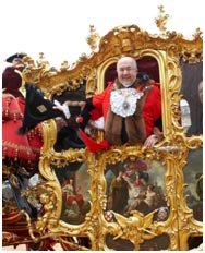 Ian Lider, Lord Mayor of London for the year 2008/9, waves from the State Coach on his way to swear loyalty to the Crown.
