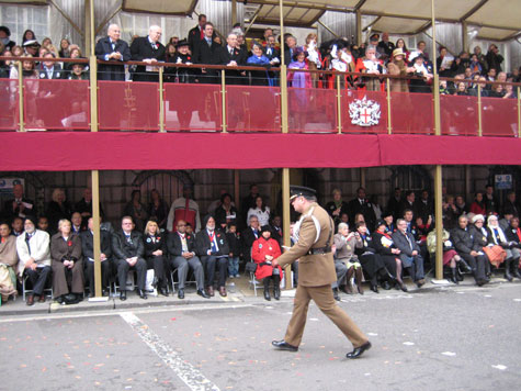 The Lord Mayor's Aide-de-Camp after he posted some mail in GPO2 on behalf of the Lord Mayor. In the stand above are the Lord Mayor and the rest of the official party.