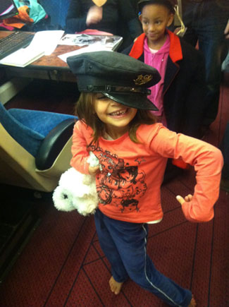 Imogen, sporting a peaked postman's cap from the GPO era