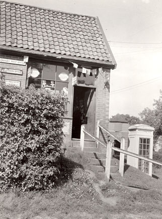 Exterior view of Chailey Post Office, with a telephone box situated alongside, 1937