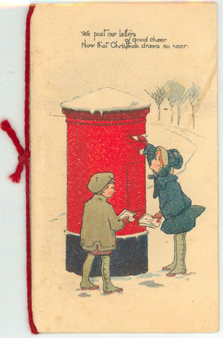 Christmas card: Image shows two young children posting letters in a letter box with snow on dome.