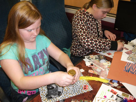 Girls working on collages.