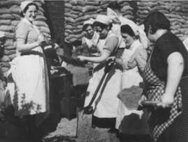 A still from The First Days: nurses volunteer to fill sandbags