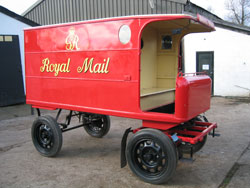 A horse-drawn mail van circa 1935 in our collection. The design of the van enabled letter carriers to step on and off whilst the vehicle was still moving.
