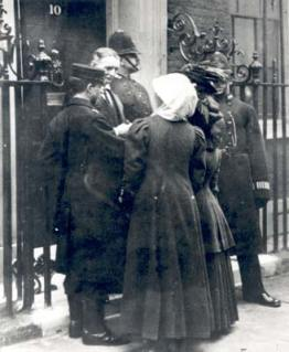 """Human letters"" – Telegraph messenger boy A.S. Palmer delivers Miss Solomon and Miss McLellan to 10 Downing Street."
