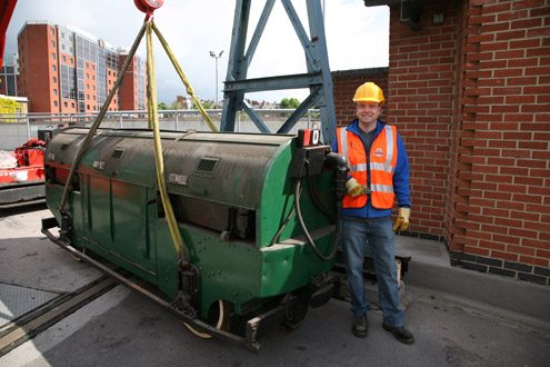 Chris Taft with the car in the Mail Rail yard at Mount Pleasant Mail Centre, London.