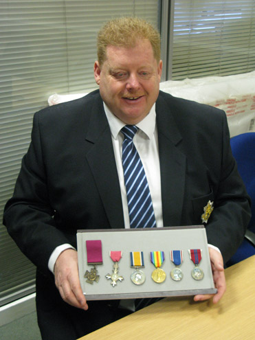 Marcus Knight viewing Alfred Knight's medals
