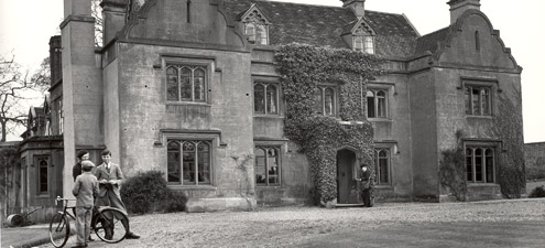 Postman delivering mail to front door of Holbeach House. (POST 118/1133)