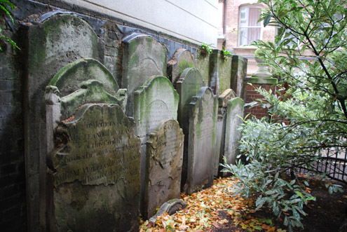 Headstones tucked in a corner
