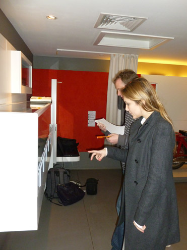 Exhibitions Officer Dominique Bignall and Head of Heritage Chris Taft check levels in the Museum of the Post Office in the Community while we are on site.