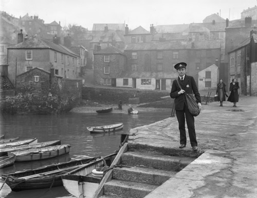 Polruan - postman standing at quayside (POST 118/250)