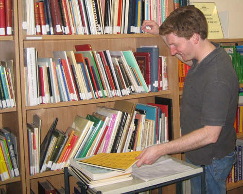 A member of staff checking library duplicates
