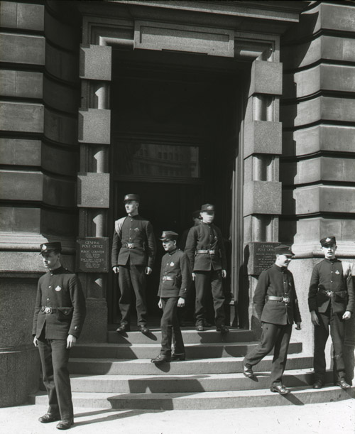 Telegram messenger boys on the steps outside of a main entrance (possibly the London Postal School), c.1930-40 (2012/0049-03)