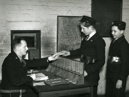 Central Telegraph Office delivery room, 1947. Jim (Dusty) Miller pictured on the right. (POST 118/1788)