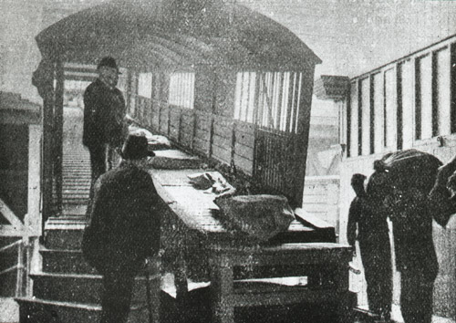 """Mails being conveyed by """"Creeper"""" from the Landing Stage to Customs Baggage Room', c.1930-c.1940 (2012-0049/40)"""