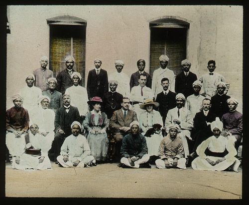 A hand-coloured photographic lantern slide of a group of men and women Post Office officials. (2012-0030/19)