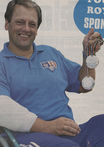 Ian Hayden with his two Barcelona Paralympics Silver Medals, which he won despite an arm injury. (Courier, October 1992)