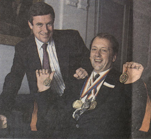 Ian Hayden with his medals from the Seoul Paralympics and other championships, with Royal Mail managing director Bill Cockburn. (Courier, January 1992)