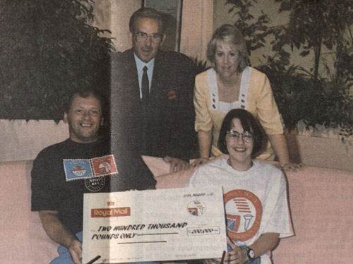 Ian Hayden (front left) with fellow Paralympian Tanni Grey (later Dame Tanni Grey-Thompson), receiving a cheque for £200,000 from postman Brian Burnham (top left) on TV-am in 1992. Also pictured is TV-am presenter Katharyn Holloway. The money was raised for the British Paralympic Team by Royal Mail employees. At this time Royal Mail was the only sponsor of both the British Olympic Association and the British Paralympic Association. (Courier, September 1992)