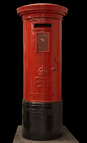 The familiar red pillar box, a rare example of one produced during the reign of Edward VIII, 1936 (OB1994.45)