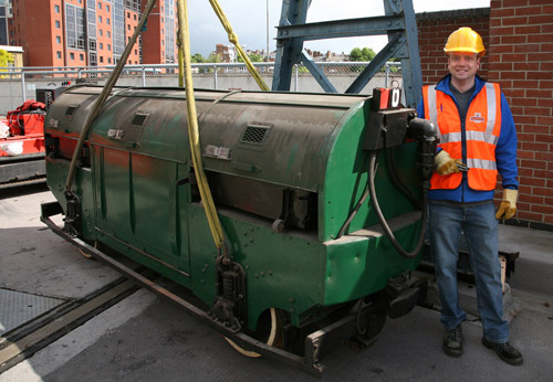 Chris Taft poses with Mail Rail rolling stock recovered from the underground tunnels at Mount Pleasant Sorting Office in London.