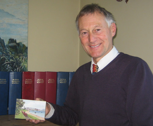 Peter Cove with the final card in his collection of postcards by the artist A. R. Quinton.