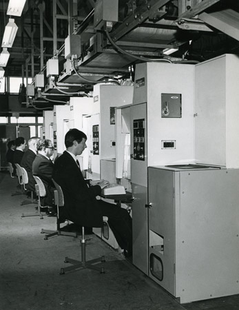 A line of postmen operating coding desks at Croydon Head Post Office, 1969. (POST 118/5424)